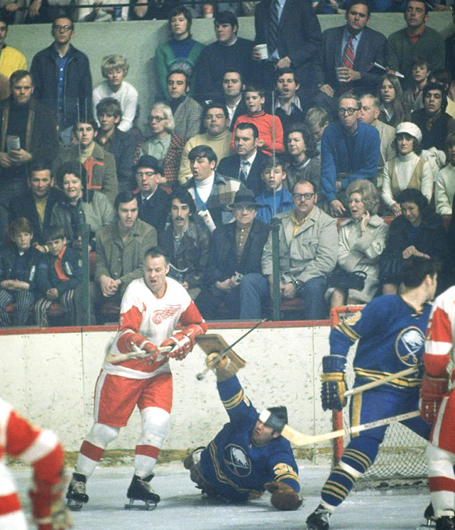Gordie Howe fights for position in front of goalie Joe Daley during a 1971 Red Wings-Sabres game. (Walter Iooss Jr./SI) GALLERY: All-Time Oldest NHL Players