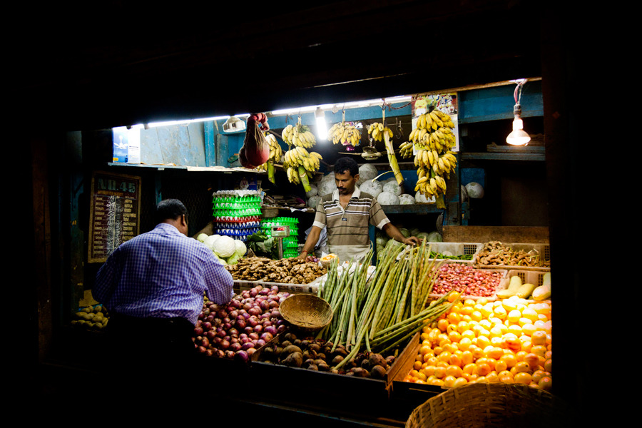 A man shops for produce at a market in Port Blair, the Andaman and Nicobar Islands, India, on May 11. Photograph by Brent Lewin/Bloomberg