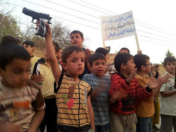 Syrian children participate in an anti-regime protest in the town of Daraa on Monday.  Photo: Matt Slocum/AP/Newscom