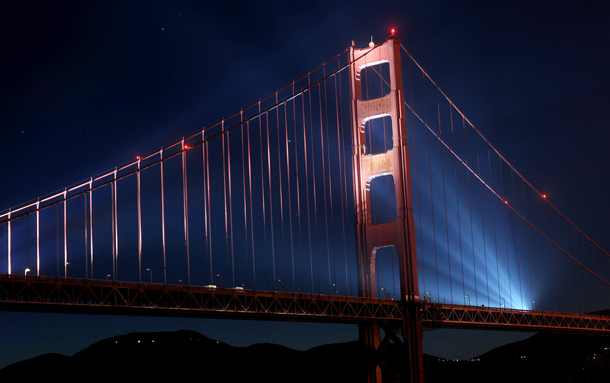From The Golden Gate Bridge Turns 75, one of 41 photos. High-power lights illuminate the Golden Gate Bridge as part of the span's 75th anniversary celebration in San Francisco, on May 27, 2012. (AP Photo/Noah Berger)