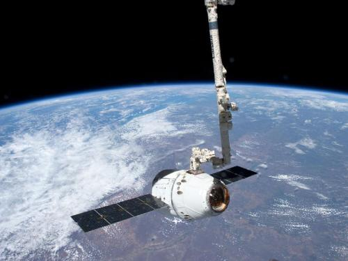 SPACEX Dragon Capsule attached to the Canadaarm of the International Space Station. Too cool! (via NASA - Canadarm2 Grapples Dragon)