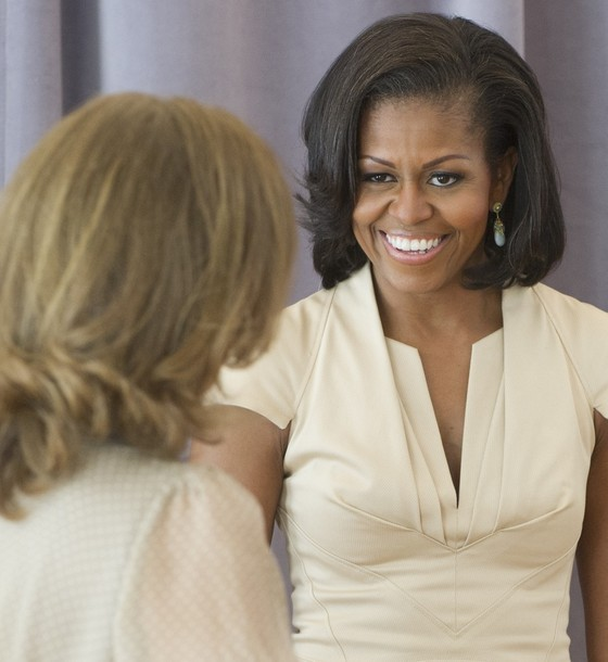 First Lady Michelle Obama chats with Valerie Trierweiler (L), partner of French President Francois Hollande, during a visit to a dance class with NATO leaders' spouses at the Gary Comer Youth Center in Chicago on May 20, 2012. The center offers area youth educational and extracurricular actitives, as well as support to help prepare them to graduate from high school and pursue college. (via Photo from Getty Images)