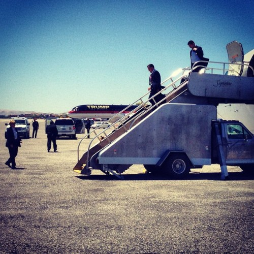 motherjones:  hollybailey:  And here's Romney exiting next to the Trump plane (Las Vegas NV) (Taken with instagram)  World historical moment.