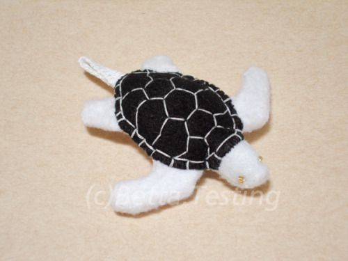 Sea Turtle (Black Shell) Materials: Arctic fleece, polyester stuffing Dimensions: Length - 3 inches, width - 3.25 inches ————— Currently available in my Etsy shop! http://www.etsy.com/listing/100912107/keychain-sea-turtle-black-white This item is made to order! Please email me if you are interested :)