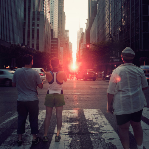 nprfreshair:  Get your cameras ready: Tonight is Manhattanhenge, friends the light. (by Vitaliy P.)  Take pictures for us Bostonians, dear Tumblr.