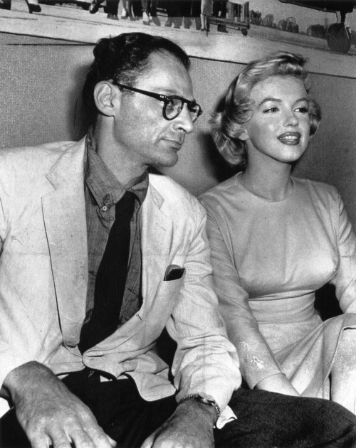 updownsmilefrown:  Arthur Miller and Marilyn Monroe waiting to board a London-bound plane July 14, 1956