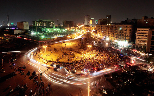 thepoliticalnotebook:  Picture of the Day: Tahrir Square in Cairo. Several thousand protesters filled the famously revolutionary Tahrir Square on Monday night to protest the presidential election, angry at being given a choice only between a Muslim Brotherhood candidate (Mohammed Morsy) and Mubarak's former prime minister (Ahmed Shafiq). Many are torn between a reluctant vote for the MB and not voting at all. Shafiq's nearby office was set on fire. Protests were also held in Alexandria, Port Said and Suez. (Read more at France24) Credit: Mohamed Abd El Ghany/Reuters. Via. View more Picture of the Day posts. Submit a photo.