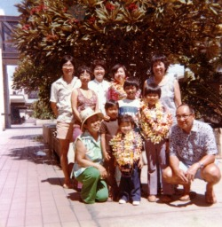 My name is Mitch Toda.  And this is a picture of my family at the Honolulu Airport on our first trip home to Hawaii after having moved to California.  I am the small kid in front with all of the leis around my neck.  I remember receiving leis whenever I went home to Hawaii each year.  As always there would be more than one; there were your flower leis, but my favorites were the candy and money leis.  As I grew up I would get leis less often, but when I did it was always for significant moments in my life: high school graduation, college graduation, and on my wedding day.