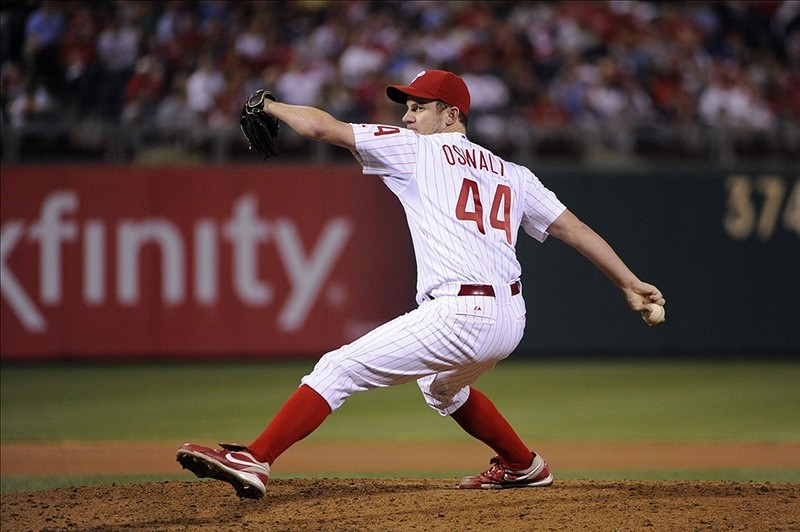Roy Oswalt is signing with the Texas Rangers. How many wins for Oswalt in 2012?