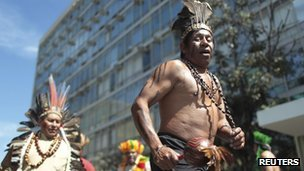 "Brazilian indigenous groups demand better healthcare Groups of indigenous people in Brazil blocked roads and occupied government buildings to demand better healthcare for their communities. Several ethnic groups staged a protest at the Health Ministry building in the capital, Brasilia, asking for a meeting with a senior official. In a statement, the movement's leaders called for better facilities and access to more doctors. They say mortality rates are on the rise among the indigenous peoples. ""The authorities promise a lot and do very little,"" said Pedro Kaingang, a spokesman for the group. He said urgent action is needed, starting by improving pay for doctors and other health workers who serve their communities. They also want better dental treatment, prescription glasses, wheelchairs and powder milk for infants. The ethnic groups who took part in the protest - Kaingang, Guarani and Charrua - come from the south of Brazil, where they also occupied government buildings. Arpinsul, the indigenous organisation behind the actions, says roads were blocked for several hours in the southern states of Rio Grande do Sul, Santa Catarina and Parana. Pictured: Health concerns: tribes take their protest to the capital"