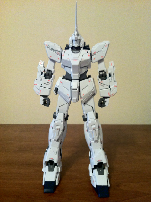 "Day 5 progress of MG Full Armor Unicorn Gundam. Finished the legs and backpack, so that's all for the Unicorn itself. Tomorrow I start on the things that make this the ""Full Armor""…and I dread it for the decals alone. You know how many weapons I have to build for this!? 2 x Beam Magnum 8 x Hand Grenade 2 x Hyper Bazooka 2 x Grenade Launcher 2 x Triple Missle Pod 3 x Shield 2 x Hyper Beam Javelin 6 x Beam Gatling Gun  And let's not forget the boosters and the Base Jabber x.x"