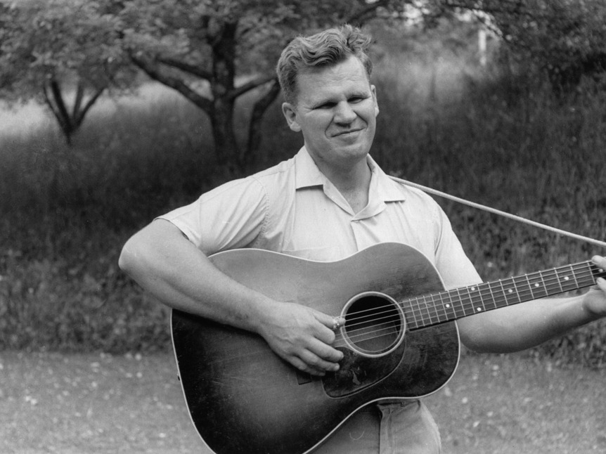 nprmusic:  A treasure of American folk music, Doc Watson, died Tuesday in North Carolina at the age of 89. He revolutionized not just how people play guitar, but how people around the world think about mountain music. Photo: John Cohen/Hulton Archive/Getty Images  Love this guy. His rendition of Mattie Groves moves me so much.