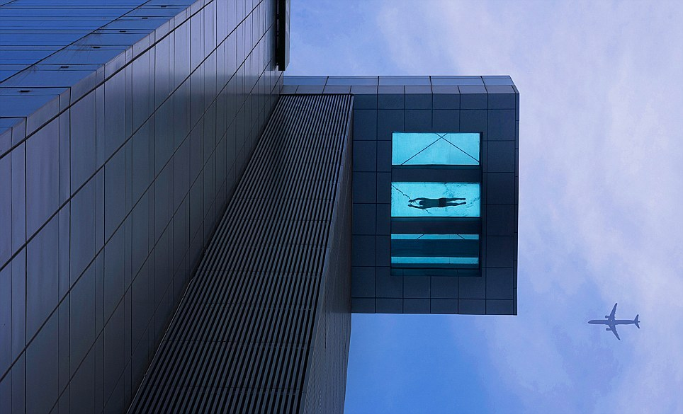 24th story glass bottom swimming pool at the Holiday Inn Shanghai, China  I want to go to there.