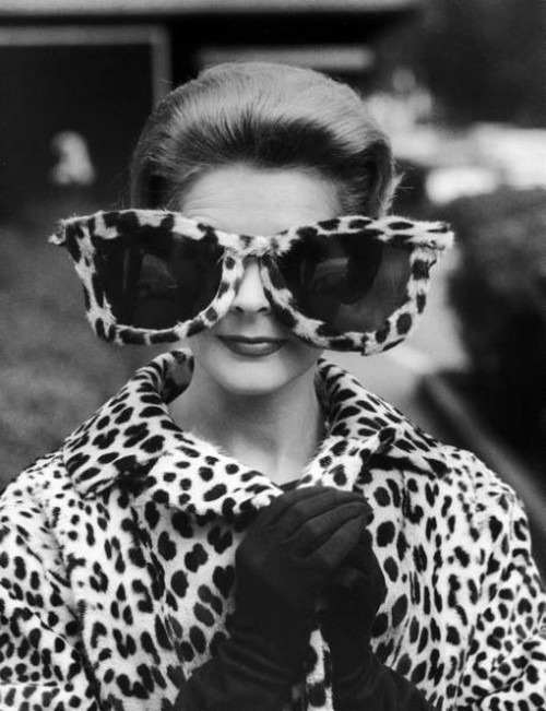 theswingingsixties:  Model June Pickney in oversized leopard skin sunglasses and coat, 1960. Photo by Stan Wayman.