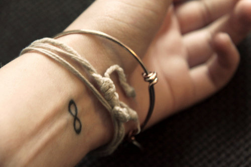 "I never liked the infinity symbol until my little sister gave me a matching bracelet that had it, she gave it to me and said, ""so you'll always remember we are sister, forever."" She's 11, how cute is that?"