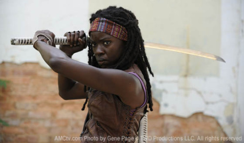 First Photo of Michonne in THE WALKING DEAD - SEASON 3 Season 3 of THE WALKING DEAD, has started production and the producers have graciously given us a photo of Michonne. You may remember at the end of last season, when Andrea was saved by a sword-wielding heroine. This would be her, minus the hood and limbless Zombie-slaves.