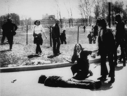 collective-history:  Mary Ann Vecchio kneels by the body of a student shot to death on the campus of Kent State University, in Kent, Ohio, on May 4, 1970. Ohio National Guardsmen fired into a crowd of unarmed anti-Vietnam War demonstrators, killing four. John Filo, AP