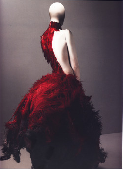 "bohemea:  Alexander McQueen Spring/Summer 2001 Dress, VOSS Red and black ostrich feathers and glass medical slides painted red Photographed by Sølve Sundsbø for Alexander McQueen: Savage Beauty ""There's blood beneath every layer of skin."""