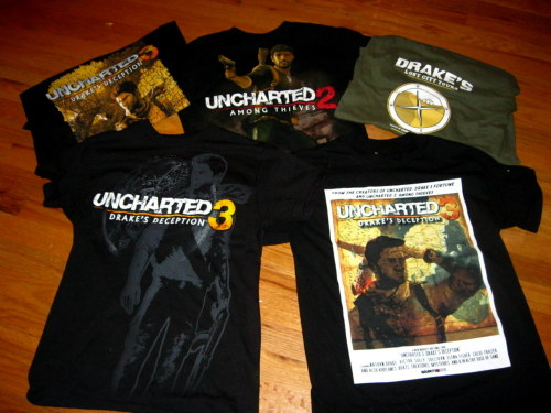 lady-of-rohan:  A while back I had posted a few photos of my Uncharted stuff in my room… but I got some new things since then and my wall is now completely covered so I figured I'd share! XD There's art on my wall by several artists here on tumblr! Nate and Elena badges by unlazy, Marlowe and Talbot keychains by sheepishsheep, and of course lots of amazing artwork by Miss Del! <3  Lots of amazing stuff in there! I wish my stuff was all together like that so I could take a picture of it. xD