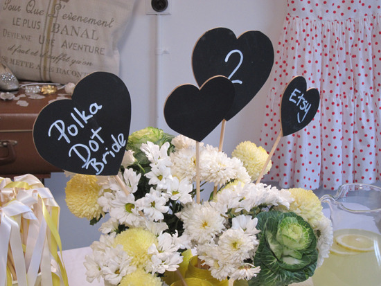 Love this tutorial for DIY chalk table numbers by Polka Dot Bride.  Photo Credit: Ms Polka Dot