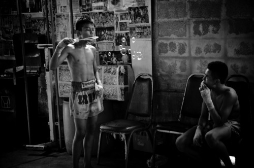 I fight, therefore I survive | Bangkok | Documentary Young boys relax after Muay Thai training.
