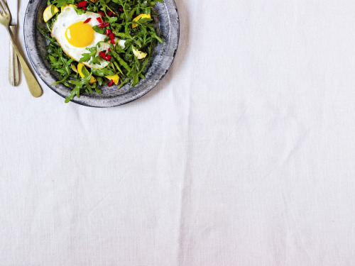 Wild rocket, summer squash and asparagus with a fried egg and hot pickled peppers recipe.  Topping a big pile of greens with a breakfast-style egg makes a tasty and complete light brunch, lunch or dinner