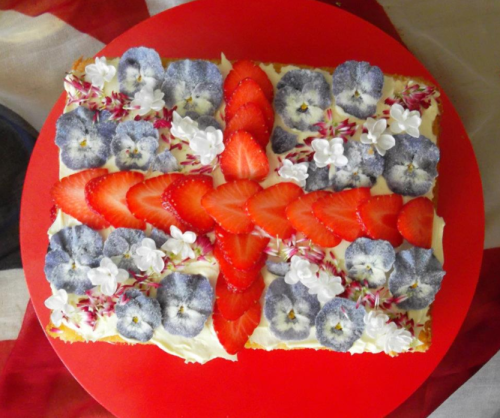 Flag Flower Cake Our friends at Bella and Fifi Flowers drew our attention to this incredible Jubilee Cake from Eat My Flowers - decorated with beautiful, edible flowers.  It's a great idea to make your Jubilee Cake stand out from the crowd, but it's important to know which flowers you can eat! Flowers from herbs such as basil and chives are edible and very pretty, but probably go best in salads rather than on top of cakes Violas, including pansies, can also be eaten and can taste like lettuce or even mint! Nasturtiums taste peppery and come in yellow, orange or red Blue flowers from Borage would look great on a flag cake, or maybe sprinkle a few over smoked salmon and sour cream blinis, since they taste like cucumbers Calendula flowers can be used instead of more expensive saffron We're loving the idea of adding flowers to our food, especially since they add flavour as well as colour!  Time to have a look in the Canopy & Stars garden…