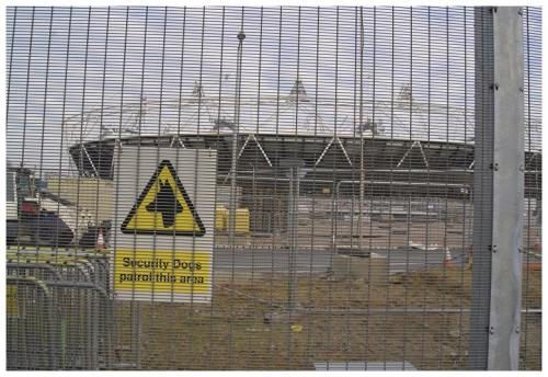 'Olympics and People: Not Very Appealing', view of the fenced Olympic Park, London 2012. Source: Joe Mason
