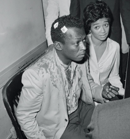 tornandfrayed:  Miles Davis and his wife Francis after his release on bail from The Tombs in Manhattan. Photo by Stanley Hall, in 1959.  More photos from the same incident.