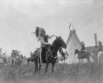 Dakota man wearing war bonnet