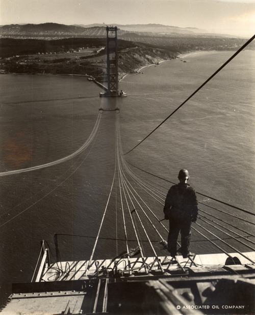 ckck:  Footbridge ropes stretch across the Golden Gate Bridge under construction. San Francisco, California, September 1935. Photograph by Charles M. Hiller. The bridge celebrated its 75th anniversary this past Sunday!