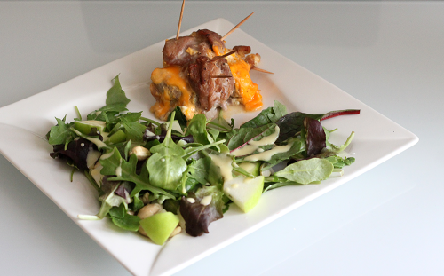 pork tenderloin filled with feta, cheddar and garlic + salad with apples, cashews and celery