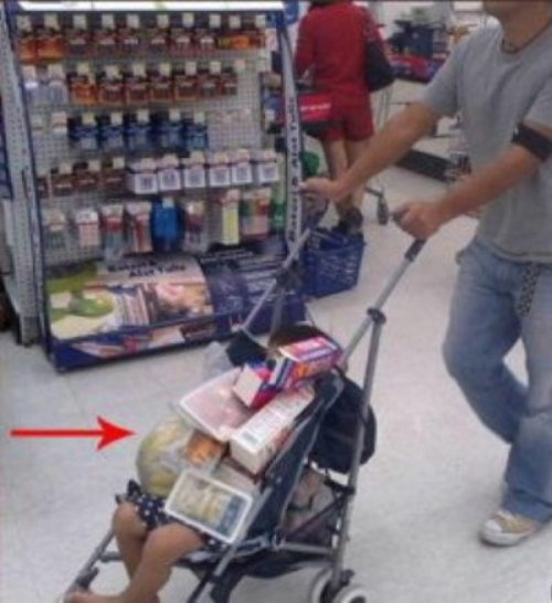 Child in Stroller Doubles as Shopping Cart Either that or he's shopping for a baby.