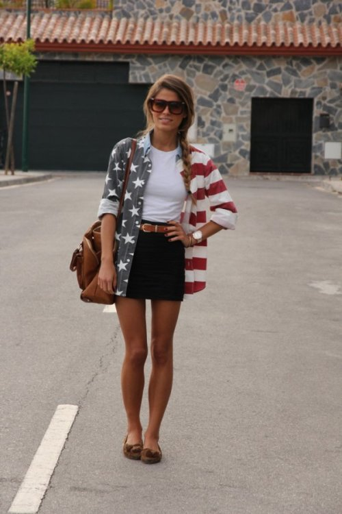 teenvogue:  Fashion Click blogger Jessie Chanes adds a playful and patriotic punch to her look with an oversized American flag-printed buttondown. Learn more about her ensemble here »