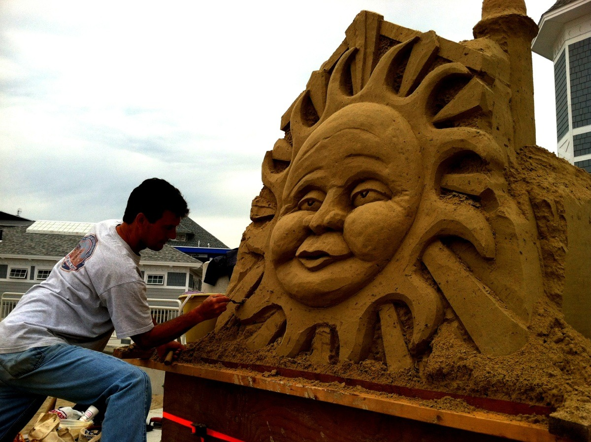 smartasshat:  I was wrong. There is sun at the beach. It's a sand sculpture, but it's still a sun.  The above picture was taken on May 30th. Below is what it looked like on September 7th when I went to The Hampton Beach Seafood Festival. I'm surprised it survived rain, wind, storms, and ne'er-do-wells so intact. Just a little damage and some plants took root. Good job, Mr. Sand Sculpture Dude.