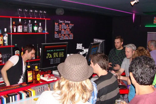 Space Station owner Matt Bloch mans the bar while customers play games
