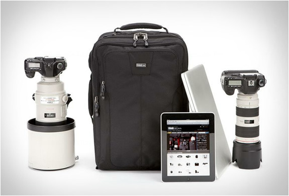 Think Tank Airport Accelerator  A legal carry on backpack which meets all domestic and international size requirements. It accommodates two pro size DSLR's, 6-8 standard zooms plus an iPad and up to a 17&rdquo
