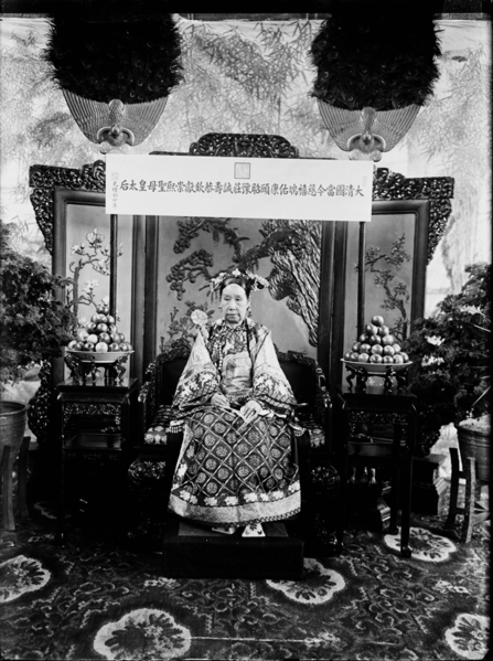 "collective-history:  Empress Dowager Cixi is shown sitting on her throne inside her bedroom chamber, the Hall of Happiness and Longevity of the Summer Palace. The plaque hanging above Cixi is inscribed with her title in full, literally translated as ""The Current Holy Mother Empress Dowager of the Great Qing Empire, Cixi (kind and auspicious) Duanyou (upright and blessed) Kangyi (healthy and well-maintained) Zhaoyu (clear and pleasant) Zhuangcheng (solemn and sincere) Shougong (long-living and respectful) Qinxian (royal and sacrificial) Chongxi (magnanimous and prosperous)."