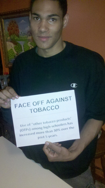 face off against tobacco in Jamaica plain on Flickr.this person supports this campain because he has a uncle who smokes alot