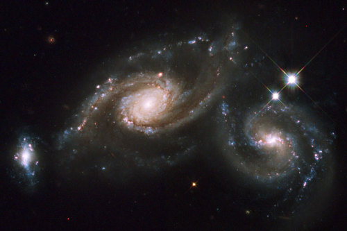 into-theuniverse:  Arp 274: colliding spiral galaxies the smaller galaxy on the left is NGC 5679