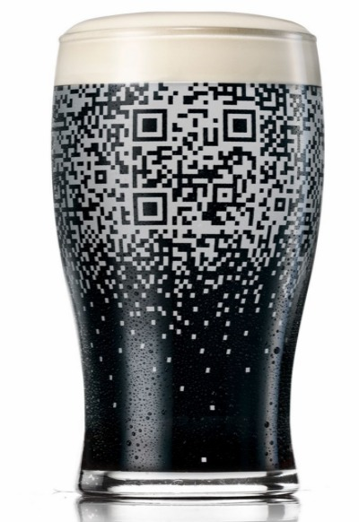 thecreativebridge:  Do you have a beer glass that can check you in to where you're drinking? Well, this one can.  Developed by BBDO in New York - if you buy a good 'ol Guinness you can update your Facebook/Twitter/FourSquare (all that good stuff so people can stalk the shit out of you) of your whereabouts and what you're drinking.  Even glasses are becomming social.  Maybe I should get a QR tattooed on my arm so people can scan me? 'Hanging out with Bridget Emmerson'. Because, you know, I'm just THAT important.