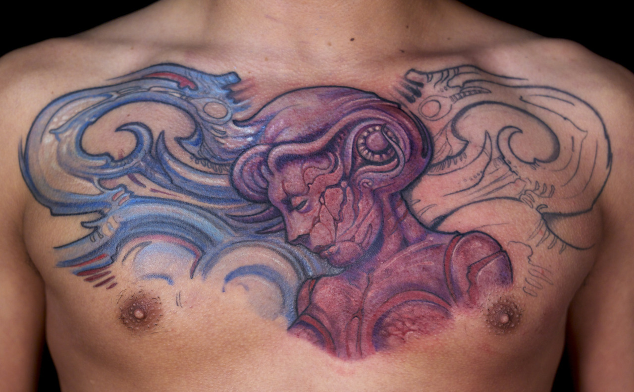 This is Loren's 3rd session on his Mucha Biomech chest panel  - sorry the color in the photo came out a bit off because his skin was still bleeding a bit.   -Paco Dietz @ Graven Image Tattoo