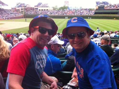 Mike and Brett model their free hats from #Cubs. Mike traveled from Atlanta for the game, while Brett was attending his first Cubs game at Wrigley Field.