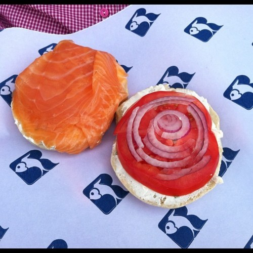 Russ & Daughters: open-faced bagel with hand-sliced smoked salmon, all-natural cream cheese, fresh tomato, and onion. Best eaten while sitting on the bench in front of the shop, just like this nice person is doing right now. http://instagr.am/p/LRNfqVD_Kn/