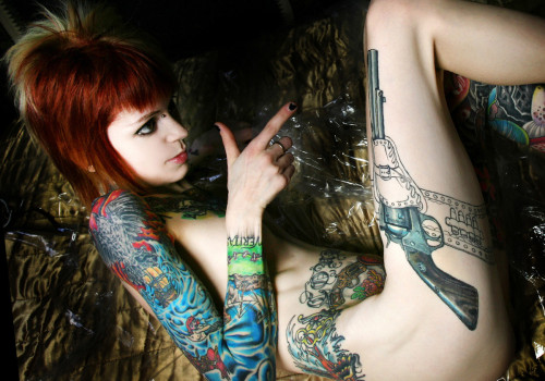 ohmygodbeautifulbitches:  Melissa Graves  That tattoo is so serious