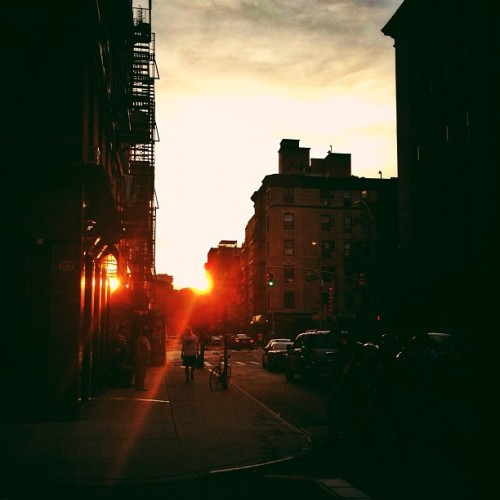 Manhattanhenge 2012. May 30th. Lower East Side, New York City.   I have taken formal photos of Manhattanhenge in previous years in midtown with the whole iconic backdrop of the Chrysler Building (they are here ).  However, I stayed in my neighborhood this time around. Kind of loving how fantastic the Manhattanhenge sunset looks on the Lower East Side. :)  Manhattanhenge is a semiannual occurrence in which the setting sun aligns with the east–west streets of the main street grid in the borough of Manhattan in New York City. The term is derived from Stonehenge, at which the sun aligns with the stones on the solstices. It was coined in 2002 by Neil deGrasse Tyson, an astrophysicist who is the director of the Hayden Planetarium at the American Museum of Natural History.  —-  View this post and interact with it on my Google Plus page   —-  View my photography for sale here, email me, or ask for help.