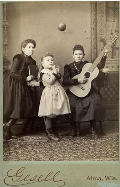 tuesday-johnson:  ca. 1860-1900, [carte de visite portrait of three young ladies; one plays the guitar, another looks at the ball suspended in the air], Gesell via Be-Hold Fine Photographs