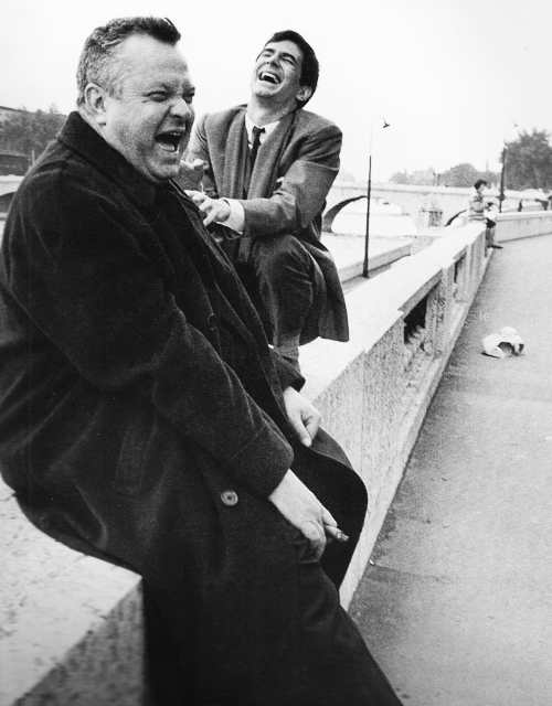 Orson Welles and Anthony Perkins laugh on the set of The Trial