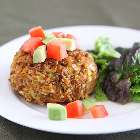 muffintop-less:  MEATLESS LENTIL BURGERS  INGREDIENTS: 1 cup dried green lentils, rinsed 6 cloves garlic, minced 3/4 cup diced yellow onion 2 celery stalks, minced 1/4 cup leeks, finely diced 2 tbsp ground flaxseed 5 tsp Dijon mustard 3 tbsp unsalted tomato paste 1 tsp chile powder 1 tsp ground turmeric 2 tsp ground cumin 1 cup cooked long-grain brown rice 2 tbsp extra-virgin olive oil INSTRUCTIONS: Preheat oven to 375°F. Line a baking sheet with parchment paper. Cook lentils according to package directions. In a large bowl, mix garlic, onion, celery, leeks, flaxseed, Dijon, tomato paste and spices. When lentils are cooked, mash them with the back  of a fork, leaving some whole. Add mashed lentils and rice to bowl. Mix all ingredients together. Heat oil in a medium saucepan on medium-high. While oil is heating, form lentil-rice mixture into 6 lentil patties. Add them to pan and cook for 2 to 3 minutes per side, until light brown. Transfer patties to prepared baking sheet and cook in oven for 15 minutes to warm through. Serve with a side salad and topped with diced tomatoes and avocado, if desired.