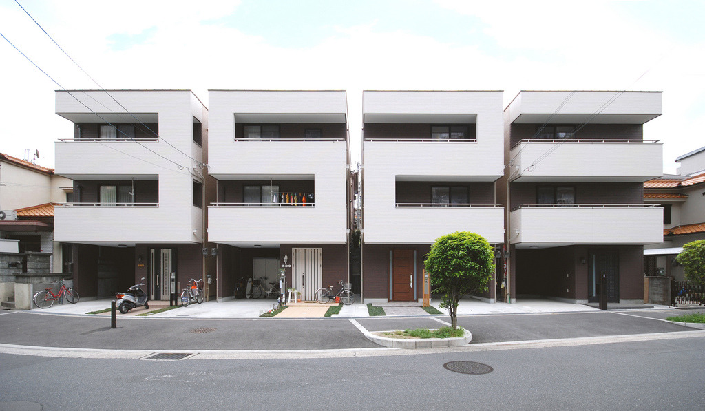Number House via Mitsutomo Matsunami Architects & Associates It's beautiful.   Mitsutomo Matsunami Architect & Associates is an Osaka based architecture firm that strives to create practicable, minimal living spaces. In 2007, Mitsutomo Matsunami completed the redesign of a set of four ready-built apartment houses by reconfiguring the building fronts showing these giant numerals. Mitsutomo Matsunami made the buildings more cohesive by making the four units appear as one building.
